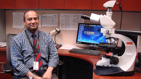 Interim Medical Director, LMP, Dr. Runjan Chetty with a microscope used to view tissue samples at a cellular level, and provide accurate diagnoses for UHN patients. (Photo: Laboratory Medicine Program)